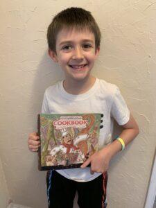 Boy with cookbook