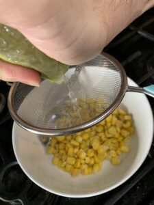 Putting lime juice on the corn